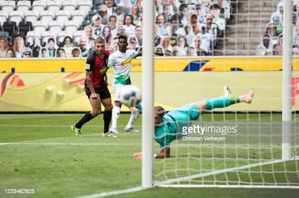 Breel Embolo of Borussia Moenchengladbach and Alexander Esswein of Hertha BSC in action during the Bundesliga match between Borussia Moenchengladbach...
