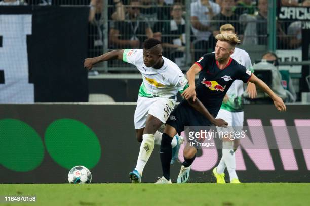 Breel Embolo of Borussia Moenchengladbach and Kevin Kampl of RB Leipzig battle for the ball during the Bundesliga match between Borussia...