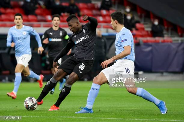 Breel Embolo of Borussia Moenchengladbach and Rodri of Manchester City battle for the ball during the UEFA Champions League Round of 16 match between...