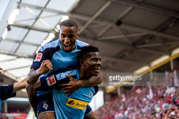 Breel Embolo of Borussia Moenchengladbach celebrate his team third goal with Alassane Plea during the Bundesliga match between 1. FSV Mainz 05 and...
