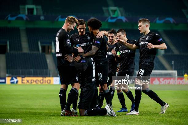 Breel Embolo of Borussia Moenchengladbach celebrate with teammates after he score his teams third goal during the Group B - UEFA Champions League...