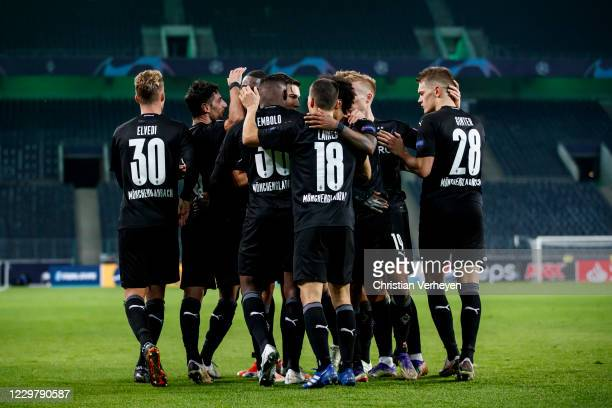 Breel Embolo of Borussia Moenchengladbach celebrate with teammates after he score his teams third goal during the Group B UEFA Champions League match...