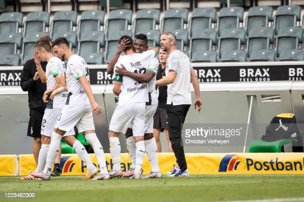 Breel Embolo of Borussia Moenchengladbach celebrate withe his team mates after he score his teams second goal during the Bundesliga match between...