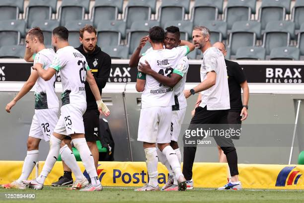 Breel Embolo of Borussia Moenchengladbach celebrates with teammates after scoring his team's second goal during the Bundesliga match between Borussia...
