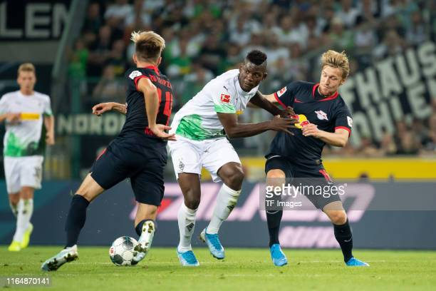 Breel Embolo of Borussia Moenchengladbach Kevin Kampl of RB Leipzig and Emil Forsberg of RB Leipzig battle for the ball during the Bundesliga match...