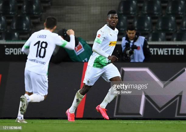 Breel Embolo of Borussia Monchengladbach celebrates after scoring his team's first goal with Stefan Lainer during the Bundesliga match between...