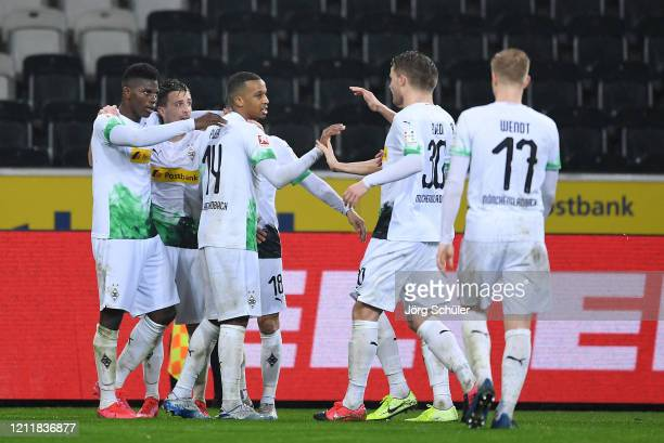 Breel Embolo of Borussia Monchengladbach celebrates his sides second goal with Alassane Plea, Stefan Lainer, Raffael and other team mates after a 1....