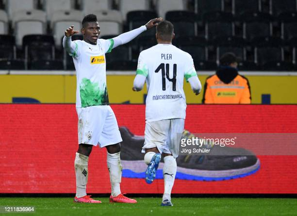 Breel Embolo of Borussia Monchengladbach celebrates his sides second goal with Alassane Plea after a 1. FC Koeln own by Jorge Mere of 1. FC Koeln...