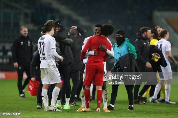 Breel Embolo of Borussia Monchengladbach embrases Leroy Sane of Bayern at full-time during the Bundesliga match between Borussia Moenchengladbach and...
