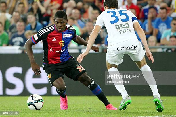 Breel Embolo of FC Basel plays the ball under pressure from Marcin Kaminski of KKS Lech Poznan during the UEFA Champions League third qualifying...