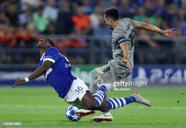 Breel Embolo of FC Schalke 04 battles for posession with Hector Herrera of FC Porto during the Group D match of the UEFA Champions League between FC...