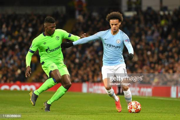 Breel Embolo of FC Schalke 04 battles for possession with Leroy Sane of Manchester City during the UEFA Champions League Round of 16 Second Leg match...