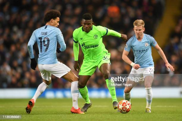 Breel Embolo of FC Schalke 04 battles for possession with Leroy Sane of Manchester City as Oleksandr Zinchenko of Manchester City looks on during the...
