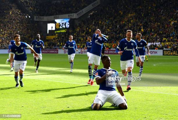 Breel Embolo of FC Schalke 04 celebrates after scoring his team's fourth goal during the Bundesliga match between Borussia Dortmund and FC Schalke 04...