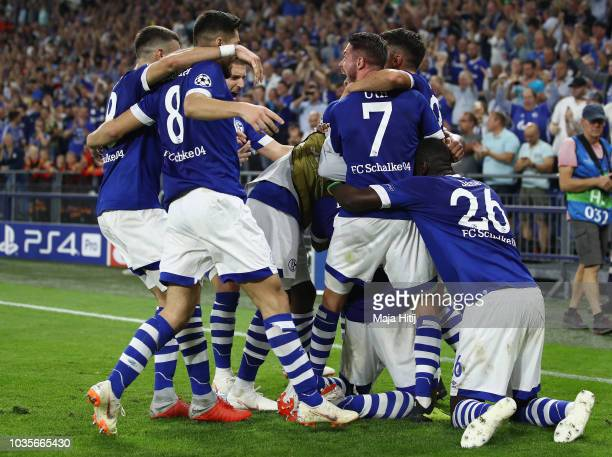 Breel Embolo of FC Schalke 04 celebrates with teammates after he scored his sides first goal during the Group D match of the UEFA Champions League...