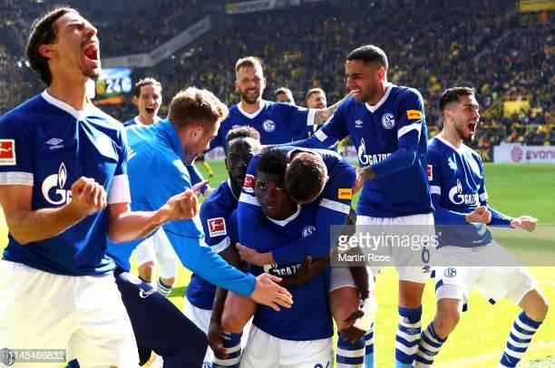 Breel Embolo of FC Schalke 04 celebrates with teammates after scoring his team's fourth goal during the Bundesliga match between Borussia Dortmund...