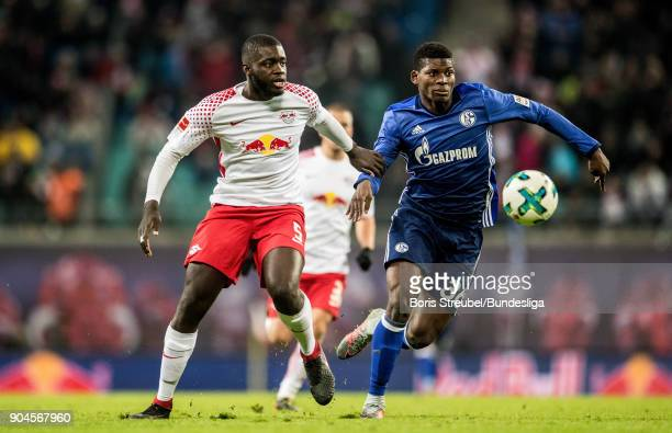 Breel Embolo of FC Schalke 04 in action with Dayot Upamecano of RB Leipzig during the Bundesliga match between RB Leipzig and FC Schalke 04 at Red...