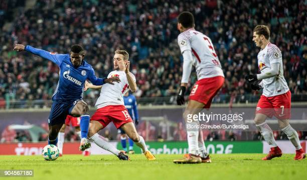 Breel Embolo of FC Schalke 04 in action with Stefan Ilsanker of RB Leipzig during the Bundesliga match between RB Leipzig and FC Schalke 04 at Red...