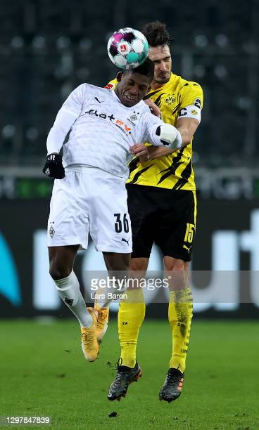 Breel Embolo of Gladbach challenges Mats Hummels of Dortmund during the Bundesliga match between Borussia Moenchengladbach and Borussia Dortmund at...