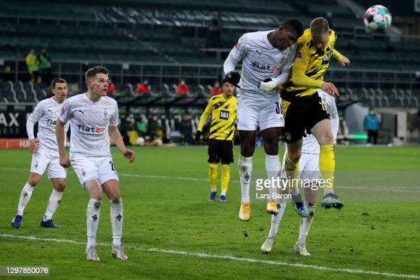 Breel Embolo of Gladbach challenges Steffen Tigges of Dortmund during the Bundesliga match between Borussia Moenchengladbach and Borussia Dortmund at...