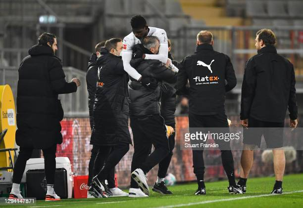 Breel Embolo of Moenchengladbach celebrates his team's first goal with head coach Marco Rose during the Bundesliga match between DSC Arminia...