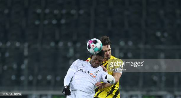 Breel Embolo of Moenchengladbach goes up for a header with Mats Hummels of Dortmund during the Bundesliga match between Borussia Moenchengladbach and...