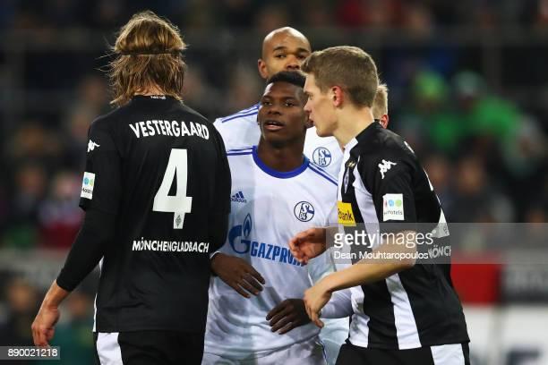 Breel Embolo of Schalke 04 battles for position against Jannik Vestergaard and Raffael and Matthias Ginter of Borussia Monchengladbach during the...