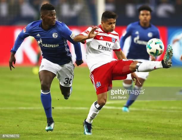 Breel Embolo of Schalke 04 challenges Douglas of Hamburger SV during the Bundesliga match between FC Schalke 04 and Hamburger SV at VeltinsArena on...
