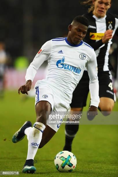 Breel Embolo of Schalke 04 gets past the tackle from Jannik Vestergaard of Borussia Monchengladbach during the Bundesliga match between Borussia...