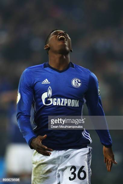 Breel Embolo of Schalke 04 reacts to a missed chance on goal during the DFB Pokal match between FC Schalke 04 and 1 FC Koeln at VeltinsArena on...