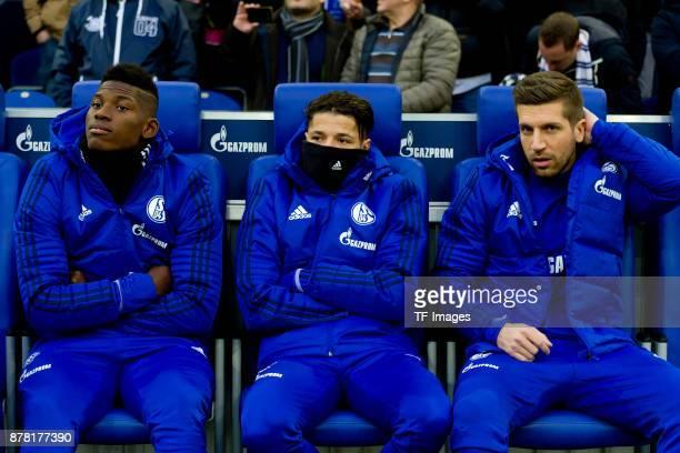 Breel Embolo of Schalke Amine Harit of Schalke and Matija Nastasic of Schalke sits on the bench prior the Bundesliga match between FC Schalke 04 and...