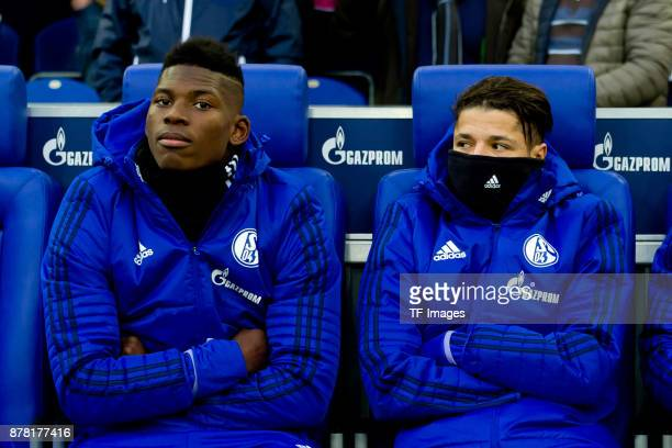 Breel Embolo of Schalke and Amine Harit of Schalke sits on the bench prior the Bundesliga match between FC Schalke 04 and Hamburger SV at...