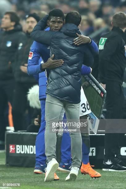 Breel Embolo of Schalke and coach Domenico Tedesco of Schalke embrace after he comes off during the Bundesliga match between FC Schalke 04 and TSG...