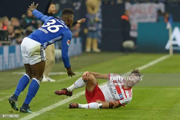 Breel Embolo of Schalke and Dennis Diekmeier of Hamburg battle for the ball during the Bundesliga match between FC Schalke 04 and Hamburger SV at...