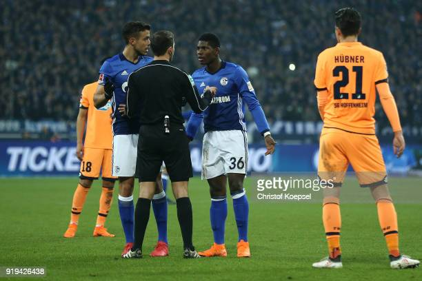 Breel Embolo of Schalke and Franco Di Santo of Schalke talk with referee Benjamin Brand after he disallowed a goal due to an offside decision during...