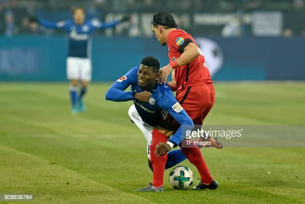 Breel Embolo of Schalke and Karim Rekik of Hertha battle for the ball during the Bundesliga match between FC Schalke 04 and Hertha BSC at...