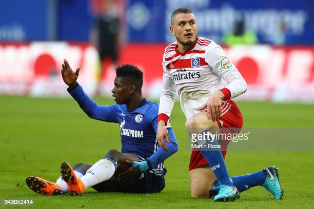 Breel Embolo of Schalke and Kyriakos Papadopoulos of Hamburg after a fight for the ball during the Bundesliga match between Hamburger SV and FC...