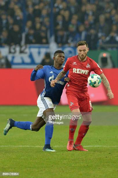 Breel Embolo of Schalke and Marco Hoeger of Koeln battle for the ball during the Bundesliga match between FC Schalke 04 and 1 FC Koeln at...