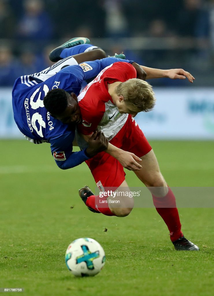 Breel Embolo (L) of Schalke and Martin Hinteregger of Augsburg battle for the ball during the Bundesliga match between FC Schalke 04 and FC Augsburg at Veltins-Arena on December 13, 2017 in Gelsenkirchen, Germany.