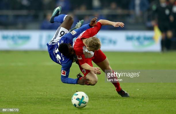 Breel Embolo of Schalke and Martin Hinteregger of Augsburg battle for the ball during the Bundesliga match between FC Schalke 04 and FC Augsburg at...