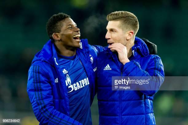 Breel Embolo of Schalke and Matija Nastasic of Schalke celebrate after winning the Bundesliga match between VfL Wolfsburg and FC Schalke 04 at...