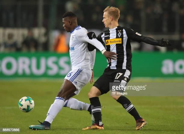 Breel Embolo of Schalke and Oscar Wendt of Borussia Moenchengladbach battle for the ball during the Bundesliga match between Borussia...