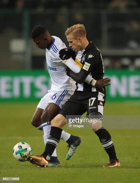 Breel Embolo of Schalke and Oscar Wendt of Moenchengladbach battle for the ball during the Bundesliga match between Borussia Moenchengladbach and FC...