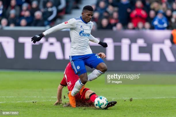 Breel Embolo of Schalke and Panagiotis Retsos of Leverkusen battle for the ball during the Bundesliga match between Bayer 04 Leverkusen and FC...