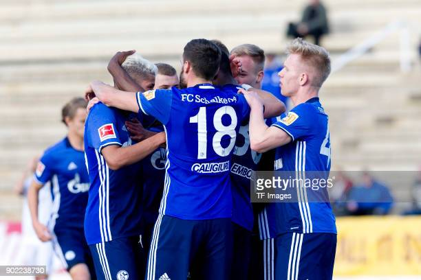 Breel Embolo of Schalke celebrates after scoring his team`s second goal with team mates during the Friendly match between FC Schalke 04 and KRC Genk...