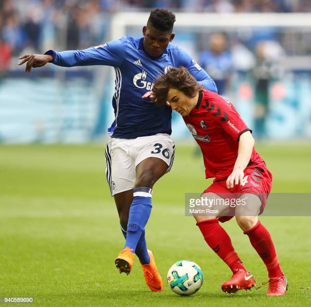 Breel Embolo of Schalke fights for the ball with Caglar Soeyuencue of Freiburg during the Bundesliga match between FC Schalke 04 and SportClub...