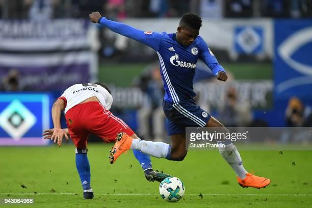 Breel Embolo of Schalke fights for the ball with Douglas Santos of Hamburg during the Bundesliga match between Hamburger SV and FC Schalke 04 at...