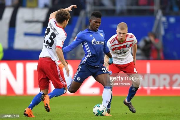 Breel Embolo of Schalke fights for the ball with Matti Ville Steinmann of Hamburg and Rick van Drongelen of Hamburg during the Bundesliga match...