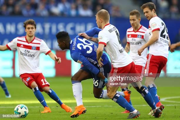 Breel Embolo of Schalke fights for the ball with Rick van Drongelen of Hamburg during the Bundesliga match between Hamburger SV and FC Schalke 04 at...