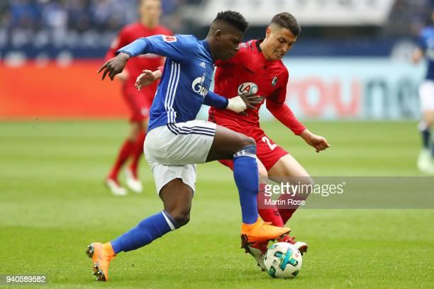 Breel Embolo of Schalke fits for the ball with Nicolas Hoefler of Freiburg during the Bundesliga match between FC Schalke 04 and SportClub Freiburg...